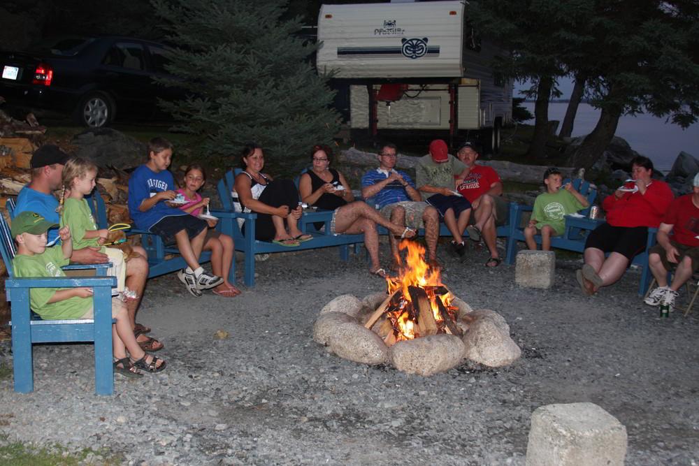 group-enjoying-the-50th-year-celebration-by-the-community-campfire-murphys-camping-nova-scotia-2010-1000px