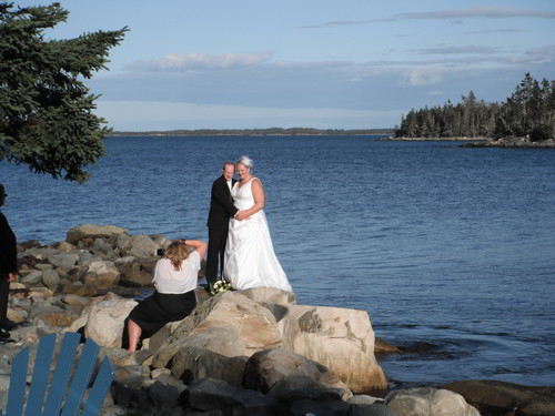 wedding-photos-being-taken-on-the-point-murphys-camping-nova-scotia-2011-500px